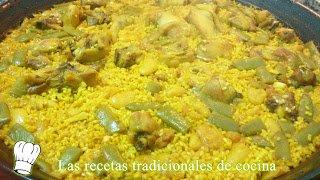 Paella valenciana con pollo, conejo y costillas al estilo de la ribera
